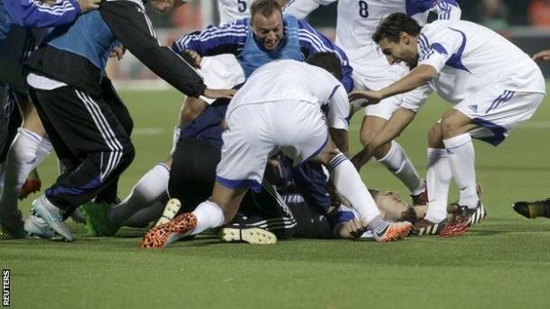 Para pemain dan ofisial San Marino merayakan gol ke gawang Lithuania | Reuters