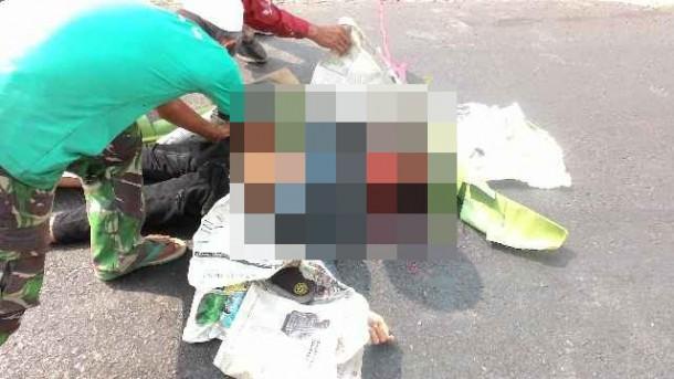 Biston Baihaki (13), pelajar SMP, tewas dalam kecelakaan lalulintas di Jalan Provinsi di Kecamatan Seputihmataran, Lampung Tengah, Kamis, 08/10/2015 | Raeza/jejamo.com