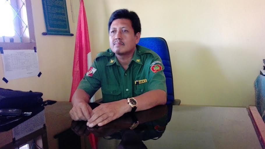 Kepala SMPN 3 Bukit Kemuning, Dahlan, Spd., MM.,| Defri/Jejamo.com