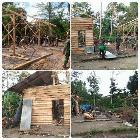 Aparat TNI bersama warga membangun kembali rumah rusak akibat bentrok Desa Sukadana Ilir Kecamatan Bungamayang Lampung Utara. | Ist.
