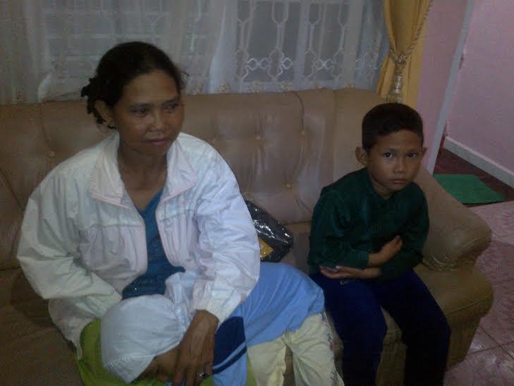 Hartini (49), RT1/ RK7, Kelurahan Kota Alam, Kecamatan Kotabumi Selatan | Buhairi/jejamo.com