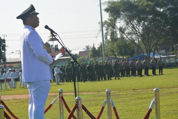 Bupati Lampung Tengah, saat menyampaikan amanat saat para peserta upacara di istirahatkan oleh pemimpin upacara | Raeza/jejamo.com