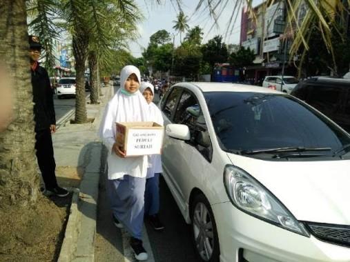 Pol PP Bandar Lampung Bubarkan Aksi Galang Dana Suriah: Kardus Dirobek, Relawan Putri Hendak Diangkut Pakai Mobil